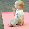 Avery Ditsworth, 15 months-old, sits on her mother's yoga mat before the Preschool Yoga/Movement session taught by Sara Guenther begins at the Mamie Doud Eisenhower Public Library on Saturday.<br /> <br /> November 18, 2011<br /> staff photo/ David R. Jennings