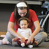 Tara Rickerson helps her daughter Max, 16 months-old, to cross her legs during the Preschool Yoga/Movement session taught by Sara Guenther at the Mamie Doud Eisenhower Public Library on Saturday.<br /> <br /> November 18, 2011<br /> staff photo/ David R. Jennings