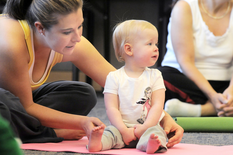 Jackie Bradley and her daughter Avery, 15 months-old, get into yoga positions during the Preschool Yoga/Movement session taught by Sara Guenther at the Mamie Doud Eisenhower Public Library on Saturday.<br /> <br /> November 18, 2011<br /> staff photo/ David R. Jennings