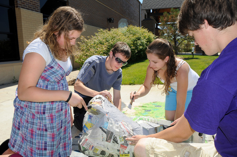 BE0708YOUTH02<br /> Regan Barr, 13, left, Nick Williams, 17, Maggie Admire, 17, and Michael Lund, 17, paint rocks for the set of the Summer Youth Players production of The Princess and the Pea at the Audi on Thursday.<br /> <br /> July 2, 2010<br /> Staff photo/ David R. Jennings
