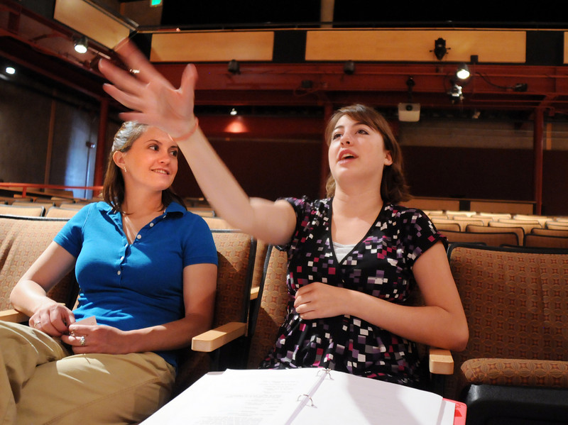 BE0708YOUTH05<br /> Student director Hailey Barr, 16, right, gives pointers to actors on stage while sitting with advisor Robin Wallace during practice for the Summer Youth Players production of The Princess and the Pea at the Audi on Thursday.<br /> <br /> July 2, 2010<br /> Staff photo/ David R. Jennings