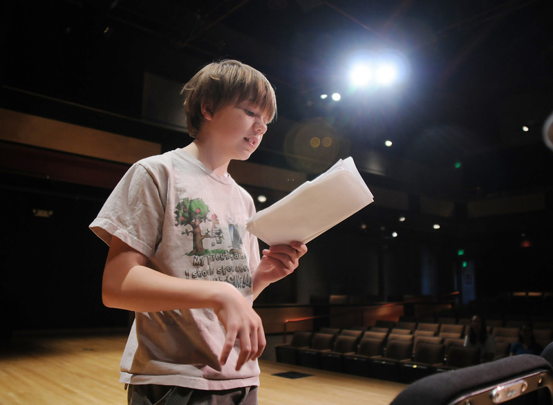 BE0708YOUTH04<br /> Garrett Labuda, 13, playing King Ulsed, reads his lines during practice for the Summer Youth Players production of The Princess and the Pea at the Audi on Thursday.<br /> <br /> July 2, 2010<br /> Staff photo/ David R. Jennings