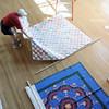 Sue Preston helps organize quilts in the lobby of the Audi for the quilt exibit for the Aster Women's Choir productin of Quilters.<br /> <br /> September 2, 2011<br /> staff photo/ David R. Jennings