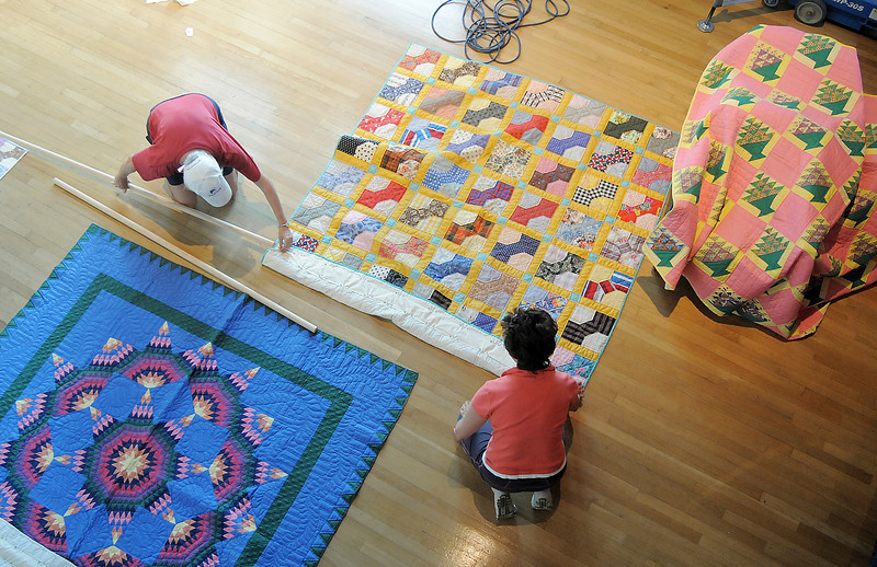 Sue Preston, left, and Katherine Linstrom work on organizing quilts in the lobby of the Audi for the quilt exibit for the Aster Women's Choir productin of Quilters.<br /> <br /> September 2, 2011<br /> staff photo/ David R. Jennings