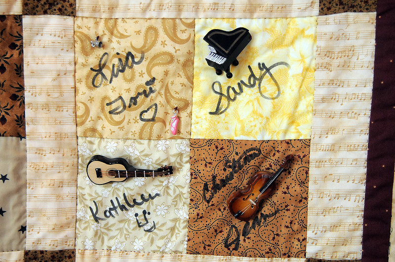 A quilt with Aster Women's Chior singers autographs hangs in the lobby of the Audi for the quilt exibit for the Aster Women's Choir productin of Quilters.<br /> <br /> September 2, 2011<br /> staff photo/ David R. Jennings