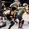 "ROLLER05.JPG ROLLER05<br /> Julie ""Angela Death"" Adams, right, jammer for the Green Barrettes, gets through the pack after evading Amy ""Moira Lee DeVoid"" Little, left, during a roller derby scrimmage at the 1st Bank Center in Broomfield.  <br /> Photo by Marty Caivano/Camera/March 15, 2010"