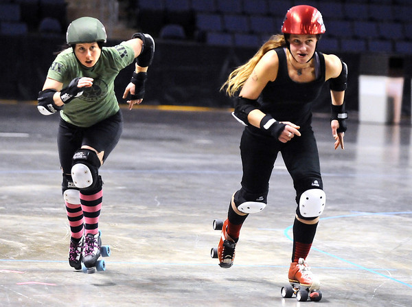 "ROLLER06.JPG ROLLER06<br /> Jammers Julie ""Angela Death"" Adams, left, and Gabrielle ""Fonda Payne"" Begeman sprint off the line during a roller derby scrimmage at the 1st Bank Center in Broomfield.  <br /> Photo by Marty Caivano/Camera/March 15, 2010"