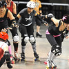 "ROLLER03.JPG ROLLER03<br /> Heather Juska, right, jammer for the Shotgun Betties, pushes through the pack after taking down Teresa ""Wicked Sister"" Rusk, left, during a roller derby scrimmage at the 1st Bank Center in Broomfield.  <br /> <br /> Photo by Marty Caivano/Camera/March 15, 2010"