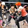 """ROLLER02.JPG ROLLER02<br /> Heather Juska, left, jammer for the Shotgun Betties, tries to evade a block from Teresa """"Wicked Sister"""" Rusk, right, during a roller derby scrimmage at the 1st Bank Center in Broomfield.  <br /> Photo by Marty Caivano/Camera/March 15, 2010"""