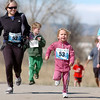 Dasha Pulai, 5, runs with her mother Anya, left, in Alex's 1K run/walk during the Frank Shorter Race 4 Kid's Health a Broomfield Rotary fundraiser for Healthy Learning Paths at the Broomfield County Commons on Sunday.<br /> April 10, 2011<br /> staff photo/David R. Jennings
