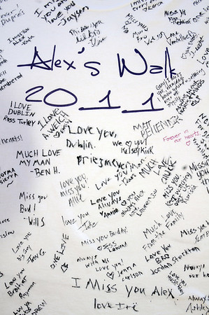 Participants and friends signed a t-shirt for Alex's Walk 1K during the Frank Shorter Race 4 Kid's Health a Broomfield Rotary fundraiser for Healthy Learning Paths at the Broomfield County Commons on Sunday.<br /> April 10, 2011<br /> staff photo/David R. Jennings