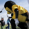 b<br /> The Applebee's Bee gives a high five to Kash Davis, 21 months old, who won the 60 foot Daiper Dash during the Frank Shorter Race 4 Kid's Health a Broomfield Rotary fundraiser for Healthy Learning Paths at the Broomfield County Commons on Sunday.<br /> April 10, 2011<br /> staff photo/David R. Jennings