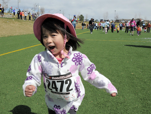 Katie McCaig, 3 3/4, runs in the Applebee's Buzz 100 yard run during the Frank Shorter Race 4 Kid's Health a Broomfield Rotary fundraiser for Healthy Learning Paths at the Broomfield County Commons on Sunday.<br /> April 10, 2011<br /> staff photo/David R. Jennings