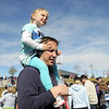 Ava Sondrup, 4, is carried by her father Ryan during the Frank Shorter Race 4 Kid's Health a Broomfield Rotary fundraiser for Healthy Learning Paths at the Broomfield County Commons on Sunday.<br /> April 10, 2011<br /> staff photo/David R. Jennings