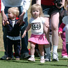 Courtney Goeken, 21 months old, center, runs in the 60 foot Daiper Rash during the Frank Shorter Race 4 Kid's Health a Broomfield Rotary fundraiser for Healthy Learning Paths at the Broomfield County Commons on Sunday.<br /> April 10, 2011<br /> staff photo/David R. Jennings