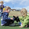 Josie Anderson, 4, right, and Kylie Ford, 4, with Kenzie Kirby, 3, play with toy bears during the Frank Shorter Race 4 Kid's Health a Broomfield Rotary fundraiser for Healthy Learning Paths at the Broomfield County Commons on Sunday.<br /> April 10, 2011<br /> staff photo/David R. Jennings