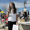 Elise Welch talks about her brother Alex Welch during the Frank Shorter Race 4 Kid's Health a Broomfield Rotary fundraiser for Healthy Learning Paths at the Broomfield County Commons on Sunday. The iK run/walk was dedicated in memory of Alex Welch.<br /> April 10, 2011<br /> staff photo/David R. Jennings