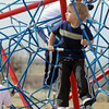Evan Gerstner, 2 1/2, plays in the playground after he won his race of  the Race4Kids' Health 5K run at Broomfield County Commons Park on Sunday.<br /> <br /> April 11, 2010<br /> Staff photo/David R. Jennings