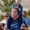 Marc Snyder carries his son Owen, 3, during the children's run of the Race4Kids' Health 5K run at Broomfield County Commons Park on Sunday.<br /> <br /> April 11, 2010<br /> Staff photo/David R. Jennings