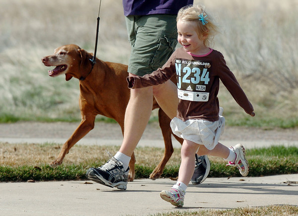 Ava Sondrup, 3, runs in the children's run during the Race4Kids' Health 5K run at Broomfield County Commons Park on Sunday.<br /> <br /> April 11, 2010<br /> Staff photo/David R. Jennings