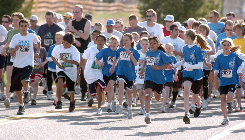 Children lead off  the Race4Kids' Health 5K run at Broomfield County Commons Park on Sunday.<br /> <br /> April 11, 2010<br /> Staff photo/David R. Jennings