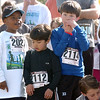 Children wait for their run to start  during the Race4Kids' Health 5K run at Broomfield County Commons Park on Sunday.<br /> <br /> April 11, 2010<br /> Staff photo/David R. Jennings