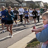 Alexa Miller, 9 months-old watches runners go by while in the arms of her father Brett during the Race4Kids' Health 5K run at Broomfield County Commons Park on Sunday.<br /> <br /> April 11, 2010<br /> Staff photo/David R. Jennings
