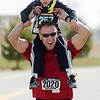 Joseph Buschmann, 4, rides on his father, David, shoulders during the children's run of the Race4Kids' Health 5K run at Broomfield County Commons Park on Sunday.<br /> <br /> April 11, 2010<br /> Staff photo/David R. Jennings
