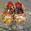 Pick Me by Karen Mandery the second place winner of<br /> the recycled art show by the Broomfield Art Guild on display at the Audi. Made from old jewelry, game pieces, pipe cleaners, Girl Scout patches, prize ribbons and shellac.<br /> <br /> July 14, 2011<br /> staff photo/ David R. Jennings