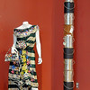 Merit winners Rock Star Girl, left, by Roxanne Macke and Totem by David Pavel for the recycled art show by the Broomfield Art Guild on display at the Audi. Rock Star Girl is made from a Mannequin, old umbrella, aluminum cans, beads, newspapers, water bottles, magazines and bottle caps. Totem is made from paint cans.<br /> <br /> July 14, 2011<br /> staff photo/ David R. Jennings