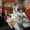 Barbara Yackle, left, Geneva Duncan with Barbara Maxwell have lunch at the meeting of the Red Hat Society's chapter the Red Hat Showoffs at the Rustic Ranch.<br /> <br /> November 12, 2009<br /> Staff photo/David R. Jennings