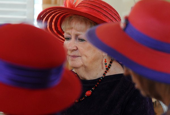 Mary Jo Newcomb at the lunch meeting of the Red Hat Society's chapter the Red Hat Showoffs at the Rustic Ranch.<br /> <br /> November 12, 2009<br /> Staff photo/David R. Jennings