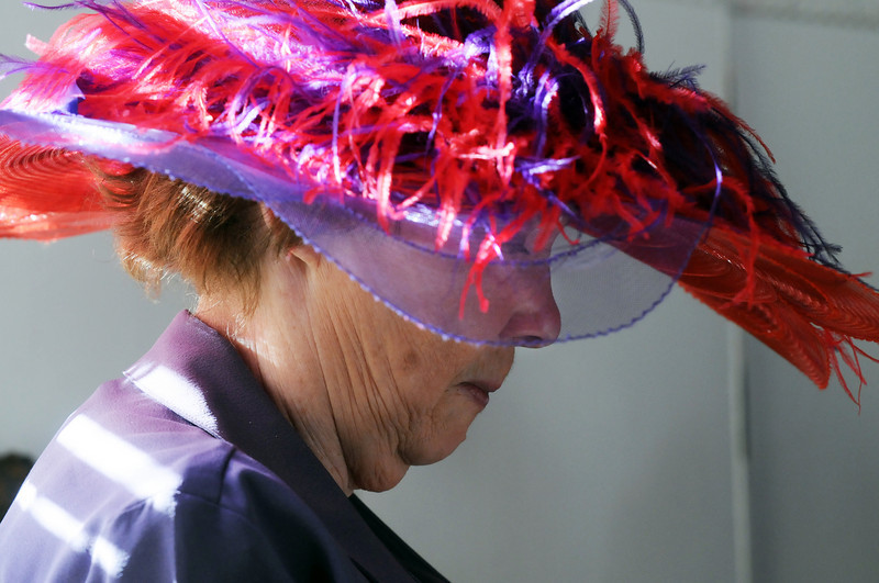 Barbara Maxwell wears a feathered hat at the meeting of the Red Hat Society's chapter the Red Hat Showoffs at the Rustic Ranch.<br /> <br /> November 12, 2009<br /> Staff photo/David R. Jennings