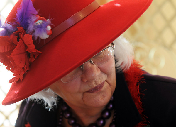 Mamie Farquhar chats during lunch at the meeting of the Red Hat Society's chapter the Red Hat Showoffs at the Rustic Ranch.<br /> <br /> November 12, 2009<br /> Staff photo/David R. Jennings