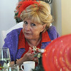 Esther Rotello is deep in conversation while having lunch at the meeting of the Red Hat Society's chapter the Red Hat Showoffs at the Rustic Ranch.<br /> <br /> November 12, 2009<br /> Staff photo/David R. Jennings