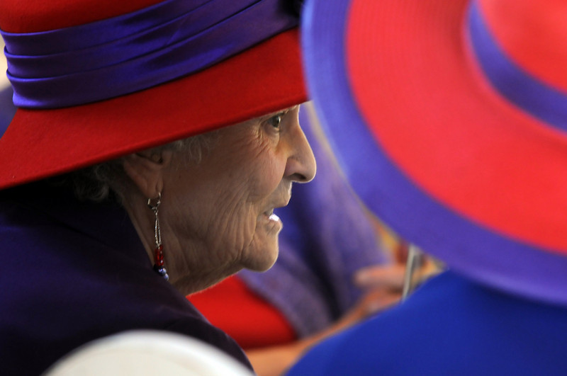 Beulah Albin converses while having lunch at the meeting of the Red Hat Society's chapter the Red Hat Showoffs at the Rustic Ranch .<br /> <br /> November 12, 2009<br /> Staff photo/David R. Jennings