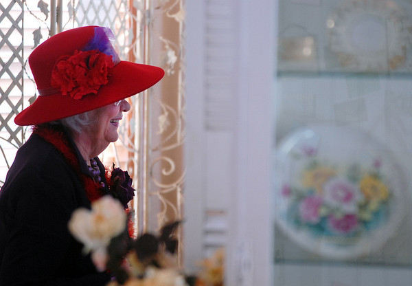 Mamie Farquhar chats while having lunch at the meeting of the Red Hat Society's chapter the Red Hat Showoffs at the Rustic Ranch.<br /> <br /> November 12, 2009<br /> Staff photo/David R. Jennings