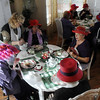 Members of the Red Hat Society's chapter the Red Hat Showoffs have lunch at the Rustic Ranch .<br /> <br /> November 12, 2009<br /> Staff photo/David R. Jennings