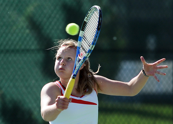 Skyline's Lisa Hug returns the ball to Centaurus' Glenna Gee-Taylor in  the # 1 singles match during the 4A region 5 playoffs at the Broomfield Swim and Tennis Club on Thursday.<br /> <br /> May 03, 2012 <br /> staff photo/ David R. Jennings