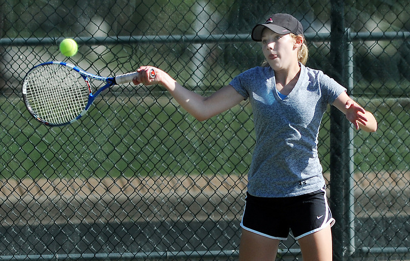 Broomfield's Katie Christman returns the ball to Thompson Valley's Hannah Gregory in  the # 2 singles match during the 4A region 5 playoffs at the Broomfield Swim and Tennis Club on Thursday.<br /> <br /> May 03, 2012 <br /> staff photo/ David R. Jennings