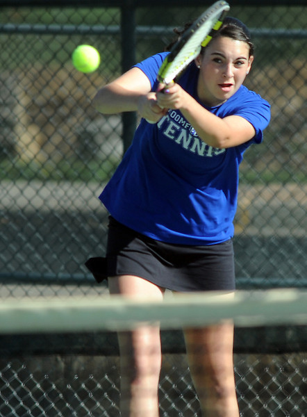 Broomfield's Marisa Eafanti returns the ball during the #2 doubles match with teammate Michele Midanier against Longmont's Olivia Lance and Kayla Perarer during the 4A region 5 playoffs at the Broomfield Swim and Tennis Club on Thursday.<br /> <br /> May 03, 2012 <br /> staff photo/ David R. Jennings
