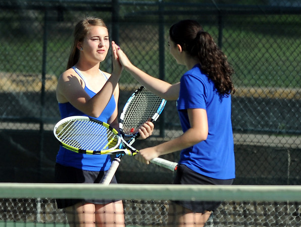 Broomfield's Michele Midanier, left, gives a high five to teammate Marisa Eafanti during  the #2  doubles match against Longmont's Olivia Lance and Kayla Perarer during the 4A region 5 playoffs at the Broomfield Swim and Tennis Club on Thursday.<br /> <br /> May 03, 2012 <br /> staff photo/ David R. Jennings