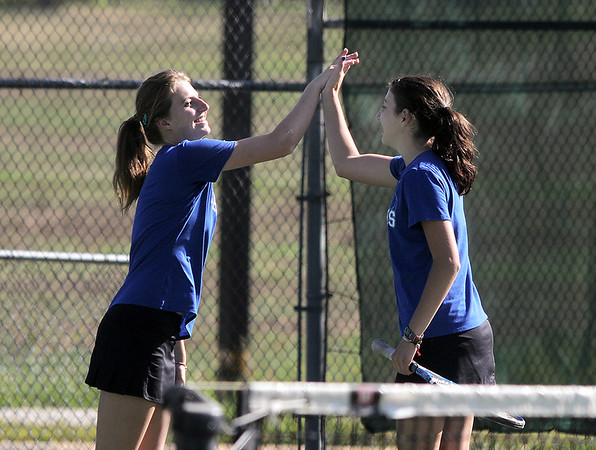 Broomfield's Shivaun Wood, left, high five's teammate Monro Obenauer during  the # 1 doubles match against Thompson Valley's Emily Erickson and Samantha Sheets during the 4A region 5 playoffs at the Broomfield Swim and Tennis Club on Thursday.<br /> <br /> May 03, 2012 <br /> staff photo/ David R. Jennings