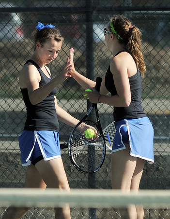 Longmont's Kayla Perarer, left, high five's teammate Olivia Lance during the #2 doubles match against Broomfield's Marisa Eafanti and Michele Midanier in the 4A region 5 playoffs at the Broomfield Swim and Tennis Club on Thursday.<br /> <br /> May 03, 2012 <br /> staff photo/ David R. Jennings