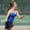 Broomfield's Michele Midanier returns the ball during the #2 doubles match with teammate Marisa Eafanti against Longmont's Olivia Lance and Kayla Perarer during the 4A region 5 playoffs at the Broomfield Swim and Tennis Club on Thursday.<br /> <br /> May 03, 2012 <br /> staff photo/ David R. Jennings