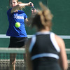 Broomfield's Shivaun Wood returns the ball during the #2 doubles match with teammate Monro Obenauer against Longmont's Olivia Lance and Kayla Perarer during the 4A region 5 playoffs at the Broomfield Swim and Tennis Club on Thursday.<br /> <br /> May 03, 2012 <br /> staff photo/ David R. Jennings