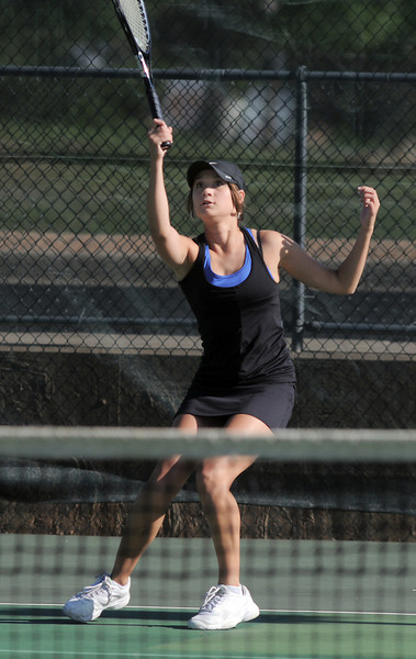 Broomfield's Madison Subry returns the ball to Thompson Valley's Shannon Galligan  in  the # 3 singles match during the 4A region 5 playoffs at the Broomfield Swim and Tennis Club on Thursday.<br /> <br /> May 03, 2012 <br /> staff photo/ David R. Jennings