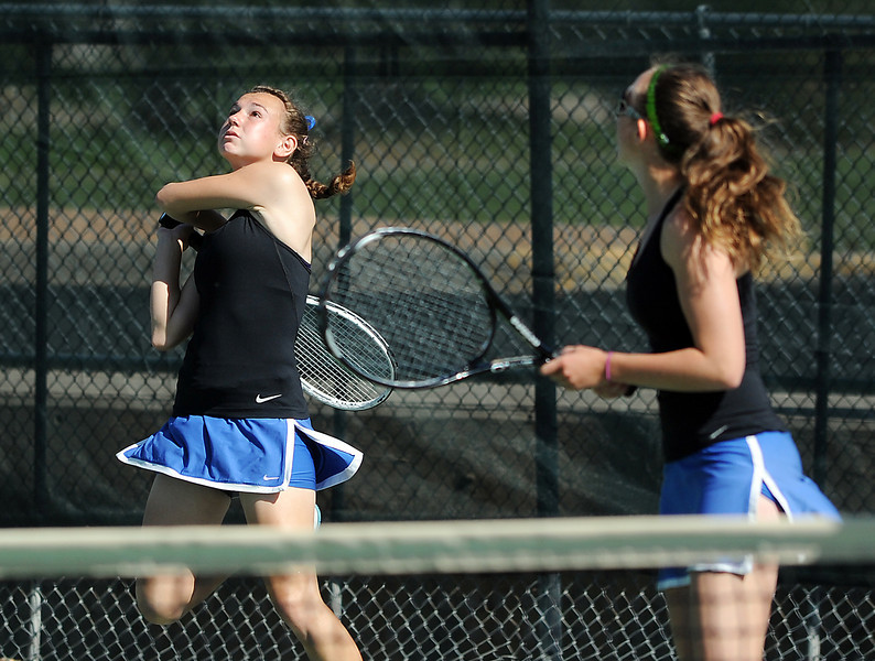 Longmont's Kayla Perarer, left, returns the ball during the #2 doubles match with teammate Olivia Lance against Broomfield's Marisa Eafanti and Michele Midanier during the 4A region 5 playoffs at the Broomfield Swim and Tennis Club on Thursday.<br /> <br /> May 03, 2012 <br /> staff photo/ David R. Jennings