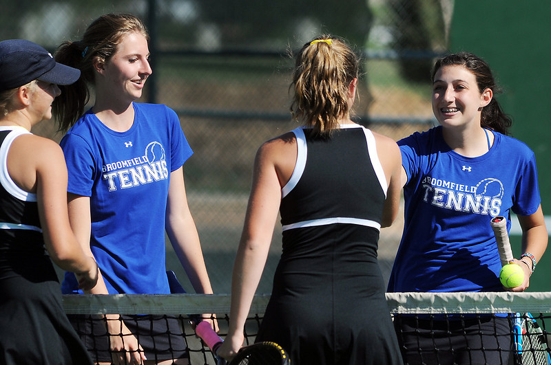 Broomfield's Shivaun Wood, left, and Monro Obenauer shake the hands of Thompson Valley's Emily Erickson and Samantha Sheets  after winning the # 1 doubles match during the 4A region 5 playoffs at the Broomfield Swim and Tennis Club on Thursday.<br /> <br /> May 03, 2012 <br /> staff photo/ David R. Jennings
