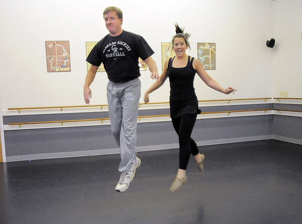 John Long and CarleeTaga rehearse their performance of a jazz dance for Dancing with the Broomfield Stars at Dance Arts Studio.<br /> <br /> August 15, 2011<br /> staff photo/ David R. Jennings